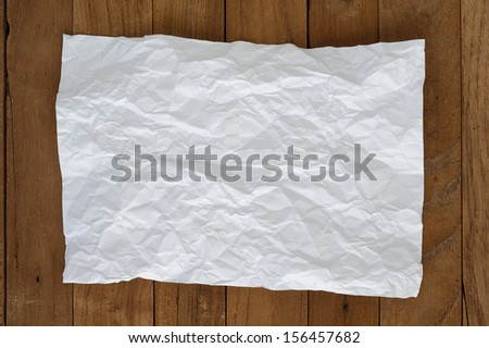 crumpled paper on wood