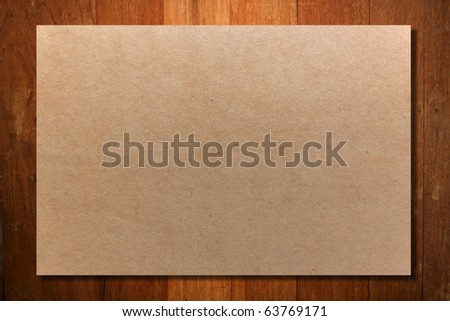 Crumpled paper on wood wall - stock photo