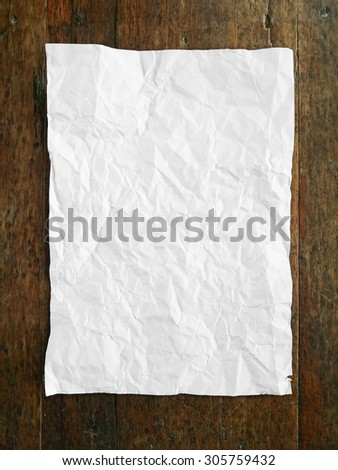 crumpled paper on wooden table