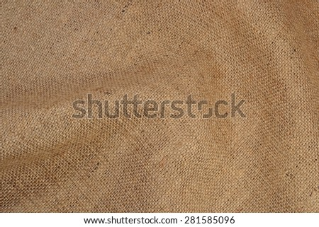 Crumpled rural brown sacking background
