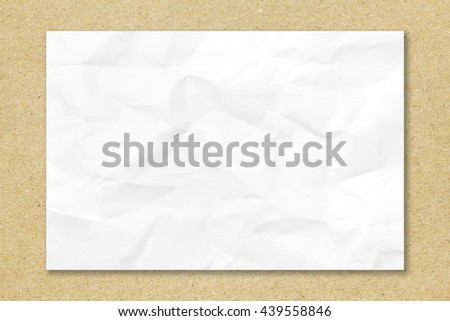 Crumpled white paper on recycled brown paper background with copy space for text or image. Blank paper texture. paper background for design. - stock photo