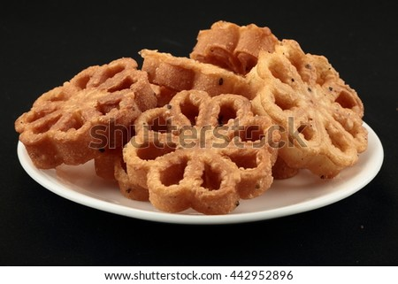 Crunchy  Achappam-- is a traditional and popular snack in Kerala during festive times like Christmas,Onam which is crunchy, mildly sweet in flower shape. - stock photo