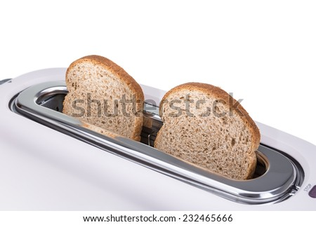 Crunchy croutons baked in a toaster. Close-up. - stock photo