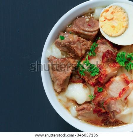 Crunchy Pork Soup on black background - stock photo