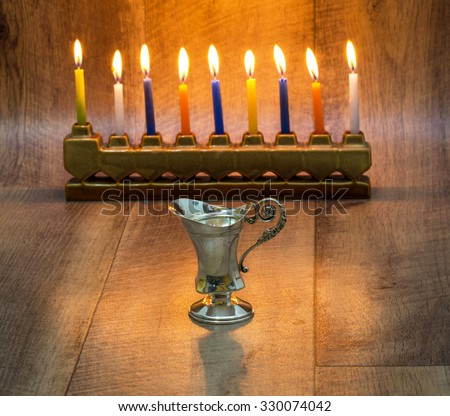 Cruse of oil  made of silver, Hanukkah - stock photo