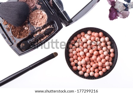 crushed compact eyeshadows with brush isolated on white background - stock photo