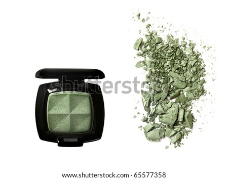 Crushed Eyeshadow and open palette isolated on white - stock photo
