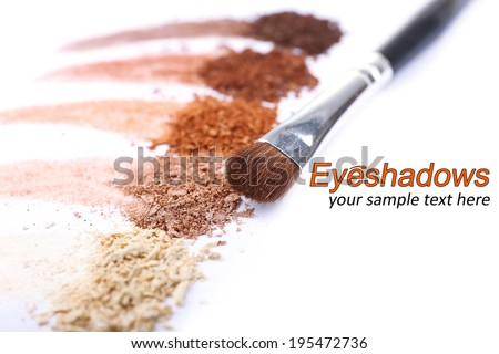 Crushed eyeshadow and professional make-up brush isolated on white - stock photo