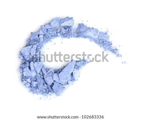Crushed eyeshadows isolated on white - stock photo