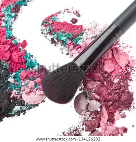 crushed eyeshadows mixed with brush isolated on white background - stock photo