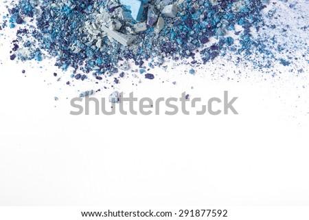 Crushed eyeshadows on white background. Beauty concept - stock photo
