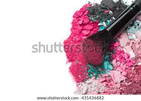 crushed eyeshadows with brush isolated on white background - stock photo