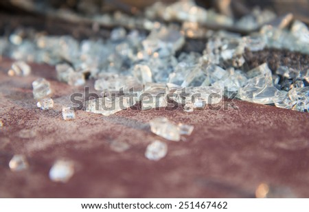 crushed glass from accident  on a car - stock photo