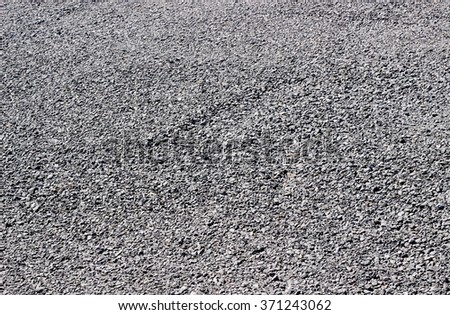 Crushed gray stone background used in construction, home driveway paving and garden landscaping  - stock photo