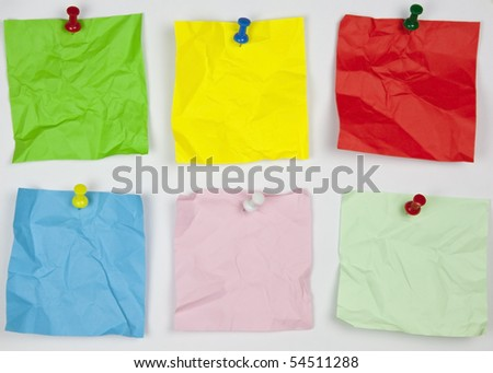 crushed many colors office paper to fasten on a wall - stock photo