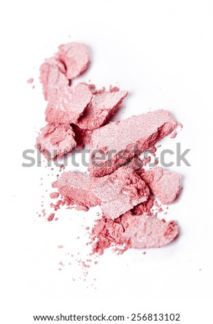 Crushed pink eye shadow isolated on white background