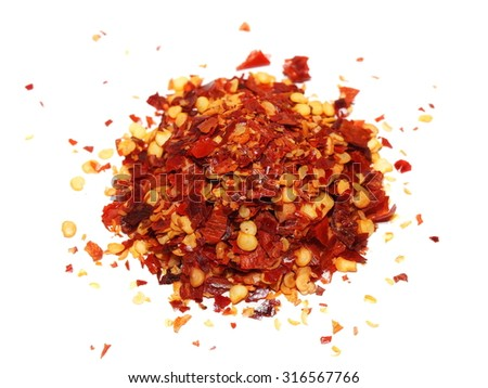 crushed red pepper, dried chili flakes and seeds isolated on white background - stock photo