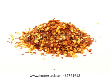 Crushed red pepper flakes, spicy and popular with pizza - stock photo