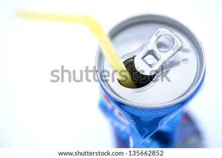 Crushed soda can with straw isolated on white background.