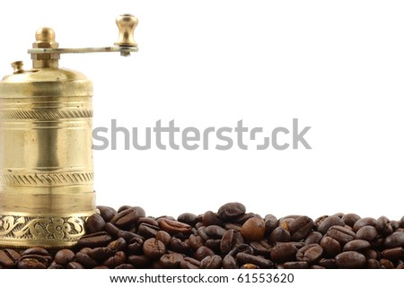 Crusher of coffee with coffee grains on a white background close up