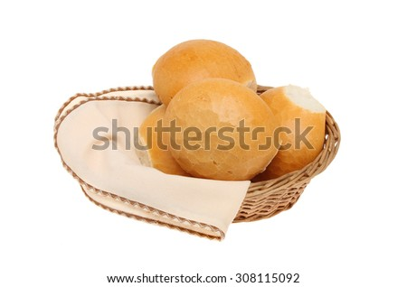 Crusty bread rolls in a basket with a serviette isolated against white - stock photo