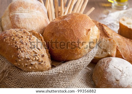 Crusty fresh bread assortment background - stock photo