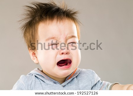 Crying baby boy - stock photo