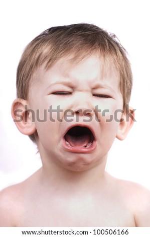 crying baby boy isolated on white, close up - stock photo