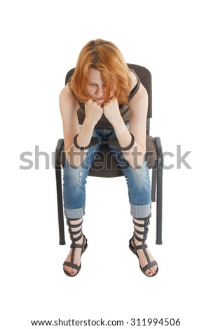 crying girl in handcuffs on a chair on a white isolate