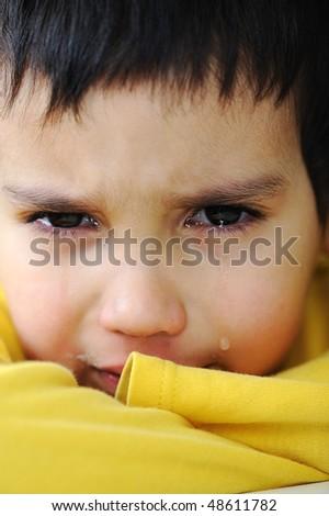 Crying kid, emotional scene, true tears - stock photo