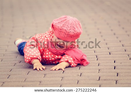 crying little girl fall off on sidewalk, kids safety - stock photo