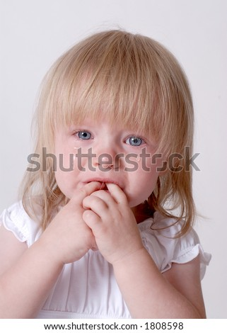 Crying Little Girl Toddler With Tears in her Eyes (4) - stock photo