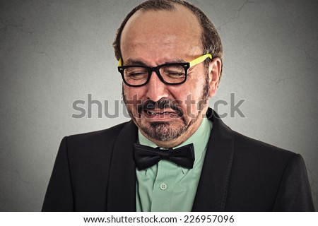 crying man isolated on grey wall background negative emotion feelings. Middle age crisis - stock photo