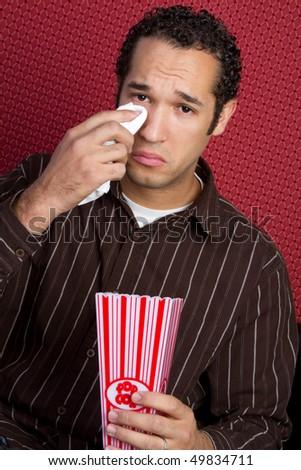 Crying Man Watching Movie - stock photo