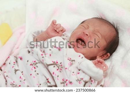 Crying newborn baby (Japanese baby girl) - stock photo
