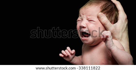 Crying newly born baby - stock photo
