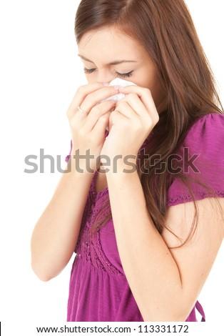 crying sad teenage girl with handkerchief, white background - stock photo