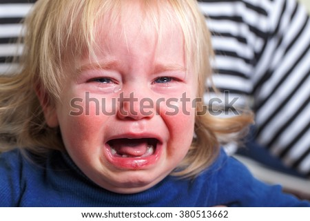 crying tears toddler with blond hairstyle