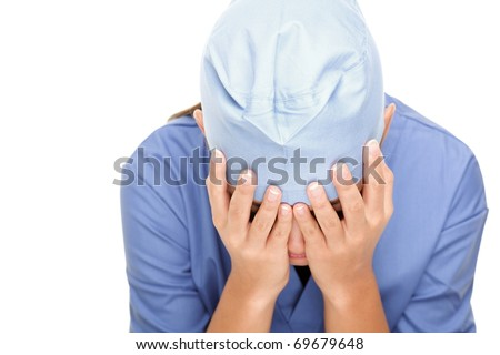 Crying unhappy upset medical nurse / doctor sad and depressed having stress breakdown. Isolated female Asian / Caucasian on white background. - stock photo