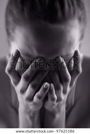 Crying woman. Black and white photo - stock photo
