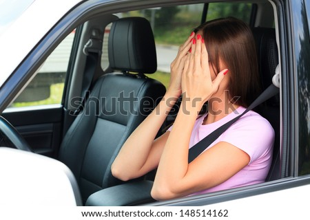 Crying woman in a car