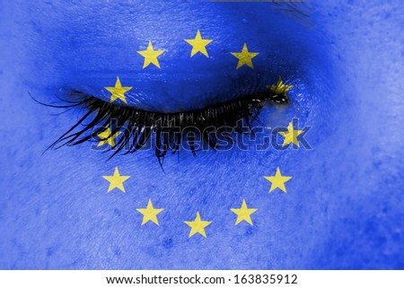 Crying woman, pain and grief concept, flag of European Union