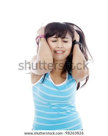 Crying woman with hands pulling her hair shot in studio isolated on white - stock photo