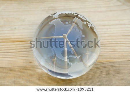 Crystal ball globe covered by wind farm