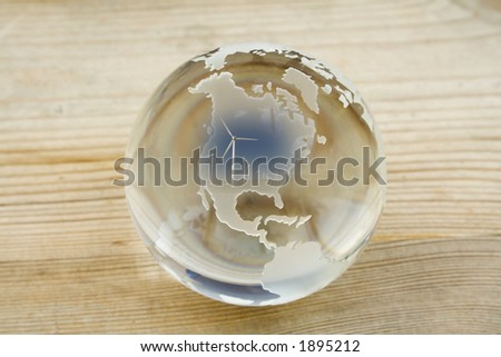 Crystal ball globe with wind farm over North America - stock photo