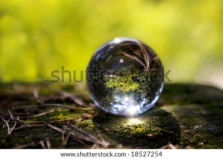 crystal ball  on nature background with soft shadow. - stock photo