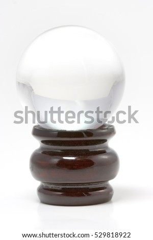 Crystal ball on wooden stand. Vertical.