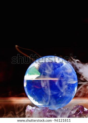Crystal Ball surrounded in mist - stock photo