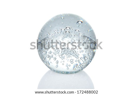 Crystal ball with bubbles and reflection isolated on white - stock photo