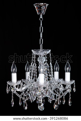 Crystal Chandelier. Group of hanging crystals. Image of grunge dark room interior with chandelier. Chrystal chandelier close-up. Luxury Glass Chandelier on white background. - stock photo